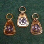 "Keychain Medallion Holders and Metal Key Tags NA Metal ""Decades"" Key Tag Lg"